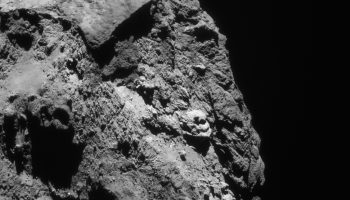 Enhanced single-frame NAVCAM view of Comet 67P/C-G on 13 June 2016, taken from a distance of 28.5 km. The image scale is 2.4m/pixel and the image measures 2.5km across. Credits: ESA/Rosetta/NavCam – CC BY-SA IGO 3.0