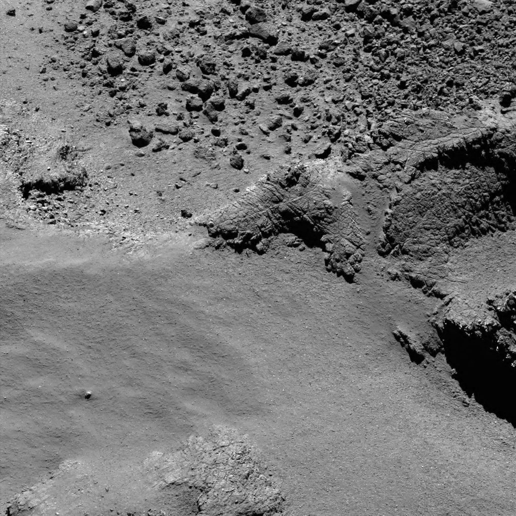 OSIRIS narrow-angle camera image taken on 3 August 2016, when Rosetta was 8.7 km from the centre of Comet 67P/Churyumov–Gerasimenko. The scale is 0.15 m/pixel at the comet and the image measures about 307 m. Credit: ESA/Rosetta/MPS for OSIRIS Team MPS/UPD/LAM/IAA/SSO/INTA/UPM/DASP/IDA