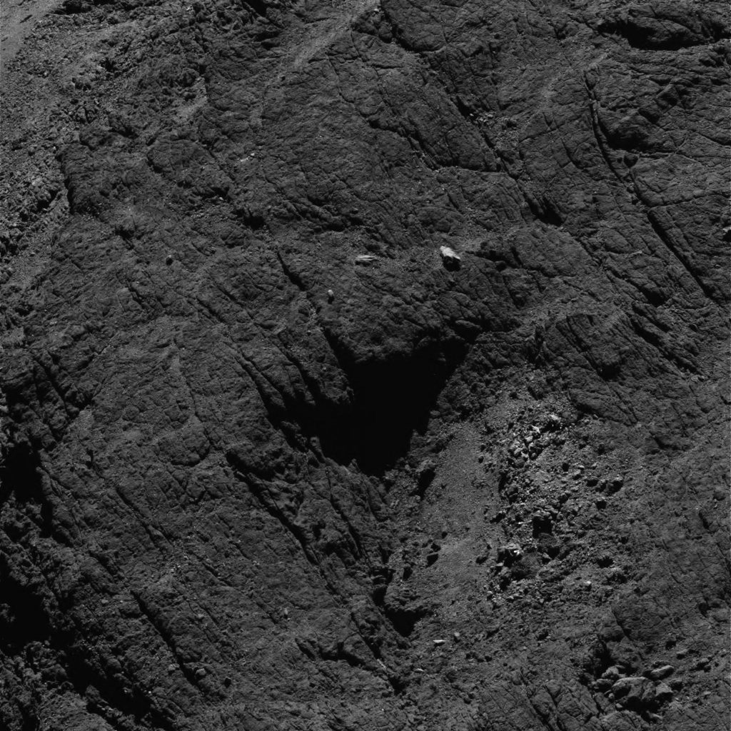 OSIRIS narrow-angle camera image taken on 6 August 2016, when Rosetta was 8.7 km from the centre of Comet 67P/Churyumov–Gerasimenko. The scale is 0.15 m/pixel at the comet and the image measures about 307 m. Credit: ESA/Rosetta/MPS for OSIRIS Team MPS/UPD/LAM/IAA/SSO/INTA/UPM/DASP/IDA