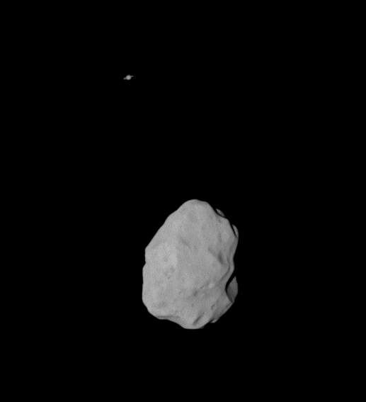 Asteroid (21) Lutetia with Saturn in the background seen from Rosetta in 2010. Credit: ESA/MPS for OSIRIS Team MPS/UPD/LAM/IAA/RSSD/INTA/UPM/DASP/IDA