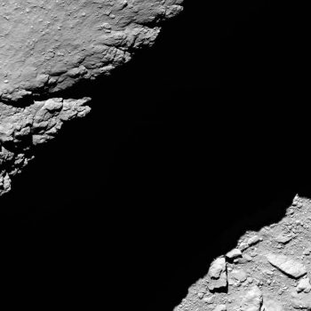 Comet 67P/C-G viewed with Rosetta's OSIRIS NAC on 30 September 2016, 1.2 km from the surface. In the lower right corner is the bottom of the pit, while the dark band crossing the image diagonally from right to left is the shadow of the pit wall; the terrain above the pit is visible in the upper left corner. Credit: ESA/Rosetta/MPS for OSIRIS Team MPS/UPD/LAM/IAA/SSO/INTA/UPM/DASP/IDA