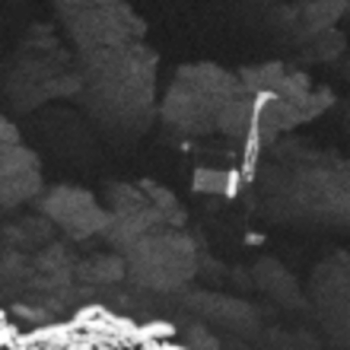 Close-up of the Philae lander, imaged by Rosetta's OSIRIS narrow-angle camera on 2 September 2016 from a distance of 2.7 km. The image scale is about 5 cm/pixel. Philae's 1 m-wide body and two of its three legs can be seen extended from the body. The images also provide proof of Philae's orientation. The image is a zoom from a wider-scene, and has been interpolated. Credits: ESA/Rosetta/MPS for OSIRIS Team MPS/UPD/LAM/IAA/SSO/INTA/UPM/DASP/IDA