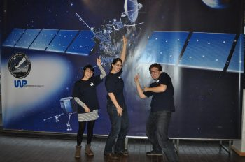 Three ROSINA PhD students trying to wake up Rosetta. Image courtesy K. Altwegg