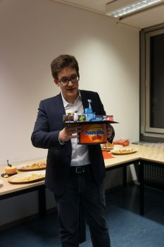 "ROSINA PhD graduate Dr Sébastien Gasc (a chocolate addict) with the thesis: ""Sensitivity and Fragmentation Calibration of the ROSINA Reflectron-type Time-of-Flight Mass Spectrometer"" - with his PhD hat made by the ROSINA team. Image courtesy K. Altwegg."