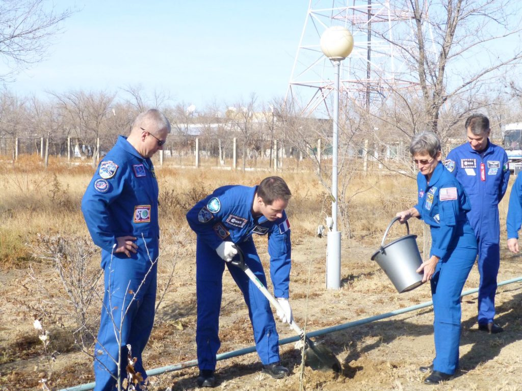 Thomas planting his tree with Oleg and Peggy.