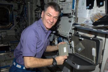 paolo_nespoli_shows_a_food_warmer_on_iss_node_full_image_2