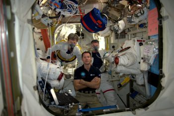 Peggy (left) and Shane (right) pre-breathing before their spacewalk with Thomas helping preparations Credits: ESA/NASA