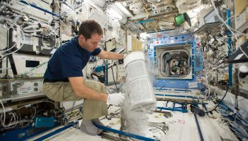 Thomas working with the Space Station freezers. Credits: ESA/NASA