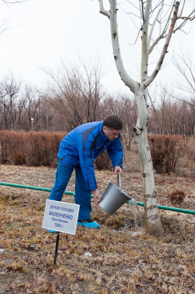 Commander Yuri Malenchenko watering his 1994 tree. Credits: NASA-V. Zelentsov
