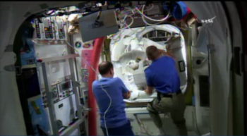 Sergei and Tim helping Scott and Tim Kopra. Credits: NASA