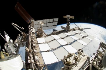 The Tim's will head past the white radiators to the Solar Arrays in the background of this picture. Credits: NASA