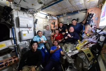 Rare space dinner with nine astronauts on Space Station in 2015. Credits: ESA/NASA