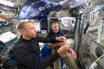 Tim Kopra drawing blood for Marrow experiment. Credits: ESA/NASA