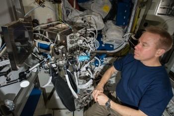Tim Kopra during Airway Monitoring experiment. Credits: ESA/NASA