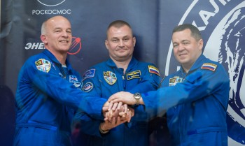 Expedition 47 crew: Flight Engineer Jeff Williams of NASA, left; Soyuz Commander Alexey Ovchinin of Roscosmos, center; and Flight Engineer Oleg Skripochka of Roscosmos, right; pose for a photo at the conclusion of a press conference on Thursday, March 17, 2016, at the Cosmonaut Hotel in Baikonur, Kazakhstan. Launch of the Soyuz rocket is scheduled for March 19 Baikonur time and will carry Skripochka, Ovchinin, and Williams into orbit to begin their five and a half month mission on the International Space Station. Photo Credit: (NASA/Aubrey Gemignani).