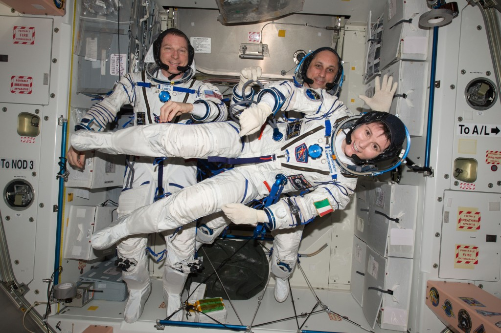 ESA astronaut Samantha Cristoforetti floating sideways with her colleagues, NASA astronaut Terry Virts (left) and cosmonaut Anton Shkaplerov in the International Space Station. They are dressed in the Sokol suits they wear in the Soyuz spacecraft that takes them to the Space Station and back. Credits: ESA/NASA