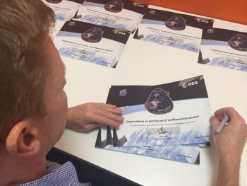 Tim signing the #spacerocks certificates that will be mailed with the patch. Credits: ESA